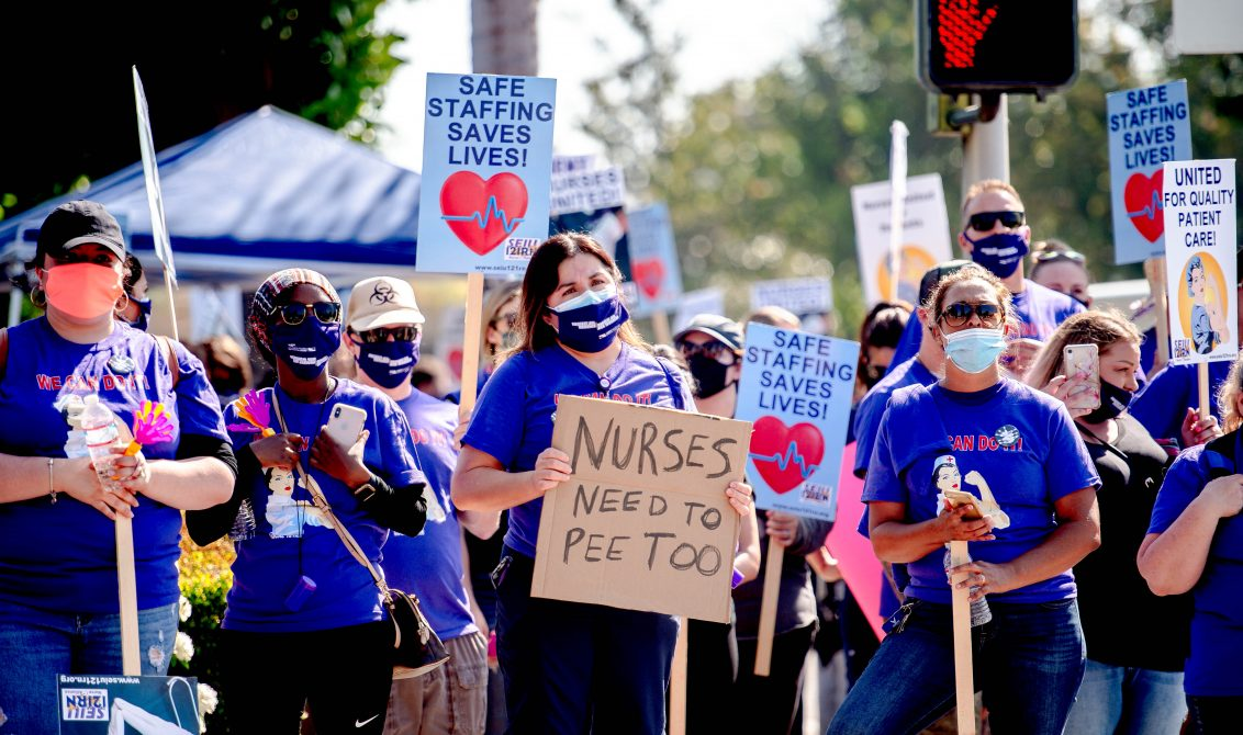 26 June 2020, US, Riverside: Riverside Community Hospital registered nurses, all members of the labor Union SEIU Local 121RN, picket outside the hospital's campus in Riverside, as they launch a 10-day strike over the patient and nurse safety issues. Photo: Watchara Phomicinda/Orange County Register via ZUMA/dpa